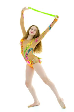A girl gymnast performs exercises with a skipping rope.