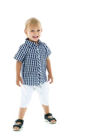 Handsome little boy in full growth on a white background.