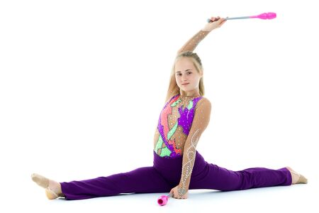 A girl gymnast performs exercises with a mace. Stock fotó