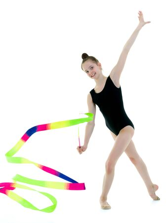 Girl gymnast performs exercises with tape. Stock fotó