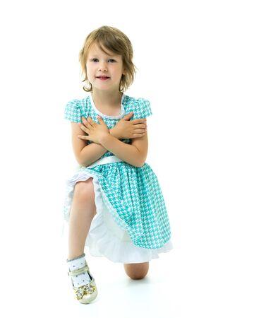 Little girl posing in studio on a white background.