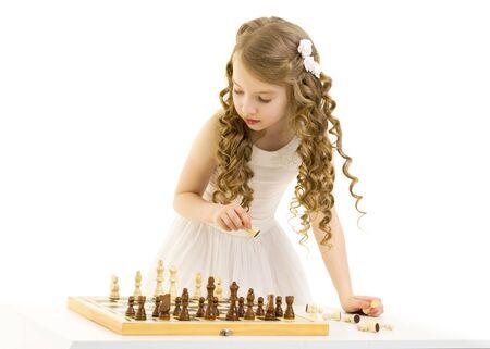 Little girl playing chess Stock fotó