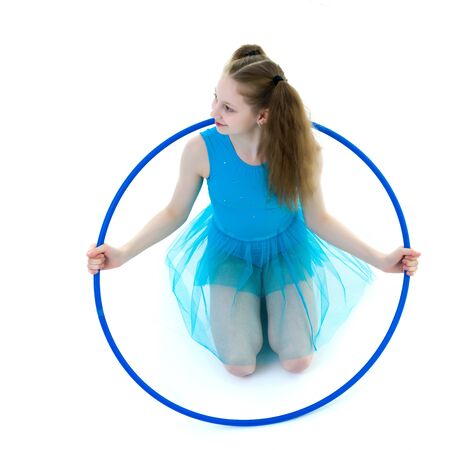 A girl gymnast performs an exercise with a hoop. Stok Fotoğraf