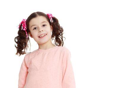 Beautiful little girl in a pink dress. Stockfoto