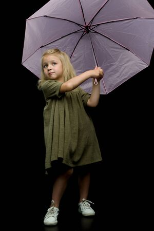 Little girl under an umbrella. protection from bad weather.
