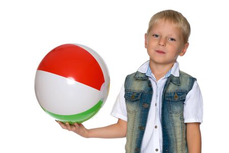 A little boy is playing with a ball. Reklamní fotografie