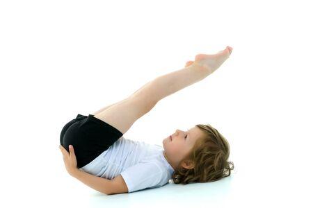 Charming little girl doing gymnastic exercises in the studio 免版税图像