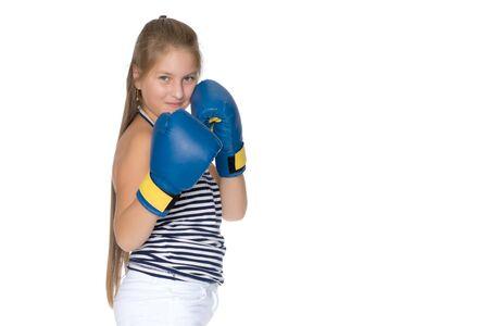 Teenage girl in boxing gloves. 写真素材