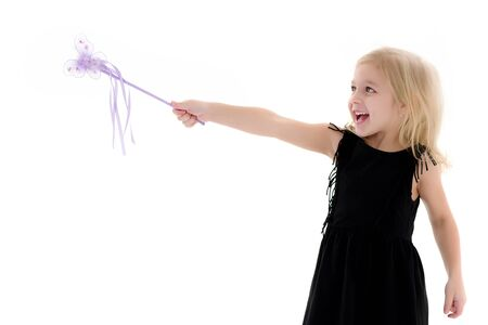 A little girl with a magic wand.
