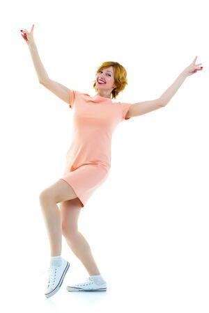 Beautiful young woman dancing isolated in studio Stockfoto