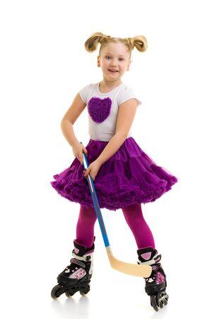 Little girl on roller skates.