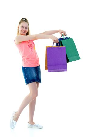 Little girl with multi-colored bags in their hands. Stock Photo