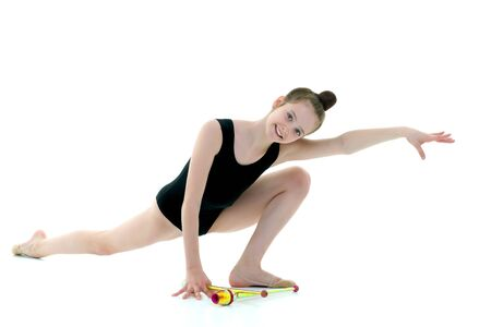 A girl gymnast performs exercises with a mace. Imagens