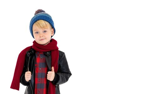 Little boy in a hat and scarf. Stock Photo
