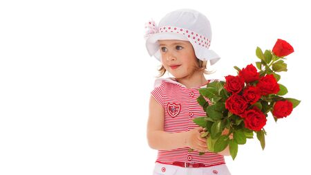 Little girl with a bouquet of flowers.Concept of holiday, summer