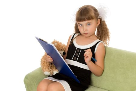 Little girl with a book.Isolated over white background Stock Photo