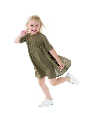Cute little girl fun running around the room. Childrens games c Standard-Bild - 131524355