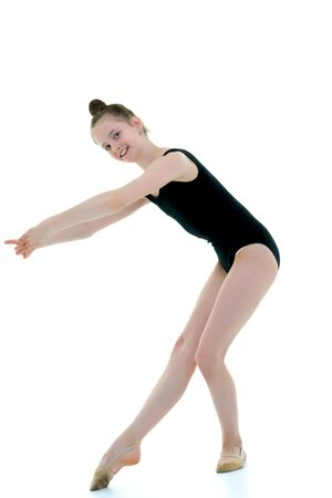 The gymnast perform an acrobatic element. 免版税图像