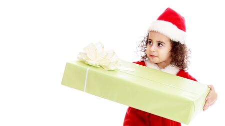 A little girl with a gift in a Santa Claus hat.