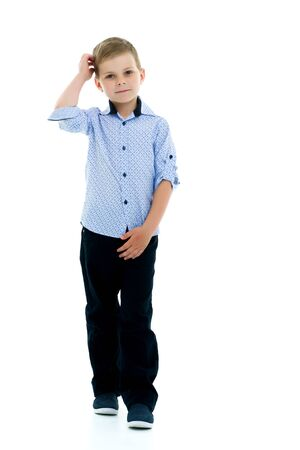 A little boy touches his forehead.Isolated on white background. Banque d'images - 131664670