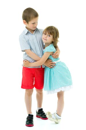 Boy and girl brother and sister gently hug