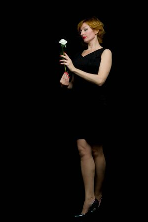 Portrait of a young woman with a white rose in her hand Stok Fotoğraf