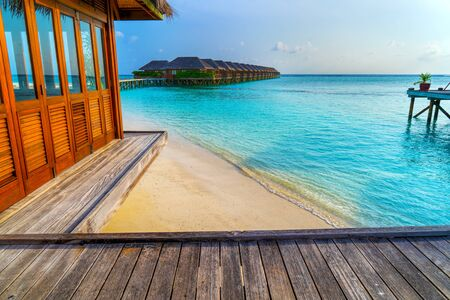 Wooden bridges leading to the huts on the shores of the tropical Stok Fotoğraf
