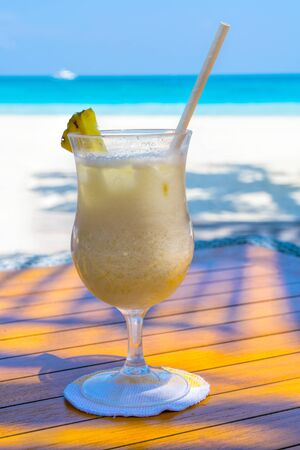 A glass of cold cocktail on a table on the beach in a restaurant Stok Fotoğraf