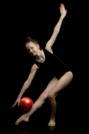 Girl gymnast performs exercises with the ball.