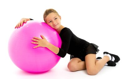Little girl is playing with a ball.The concept of childrens spo