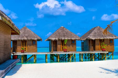 Wooden bridges leading to the huts on the shores of the tropical Reklamní fotografie