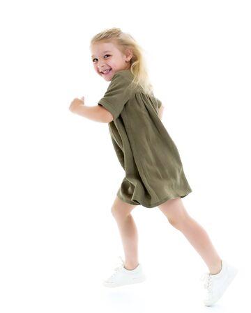 Cute little girl fun running around the room. Childrens games c