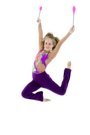 A girl gymnast performs exercises with a mace. 스톡 콘텐츠
