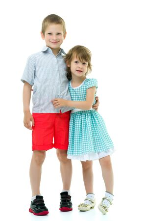 Brother and sister, boy and girl posing in the studio. Friendshi Foto de archivo - 133517598