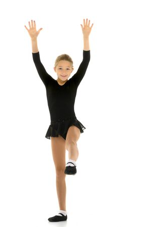 Cute little girl gymnast getting ready to perform a difficult ex Banco de Imagens