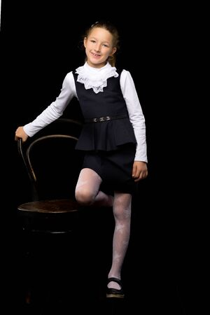 Little girl on a black background.style and fashion.