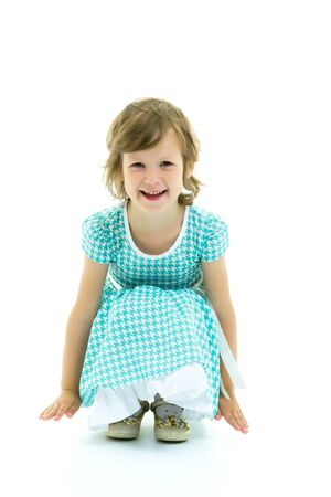 Charming little girl laughing happily in studio on white backgro
