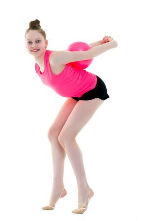 little girl is engaged in fitness with a ball. Archivio Fotografico