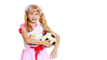 Little girl with a soccer ball.The concept of childrens sports. Zdjęcie Seryjne