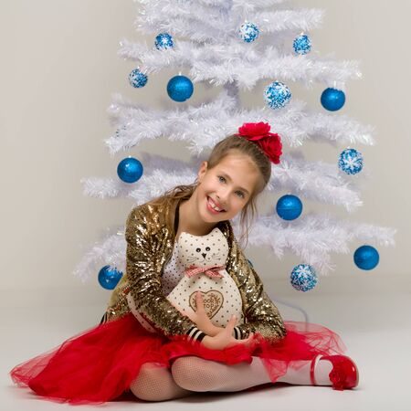 The girl at the Christmas tree.Beautiful little girl near the Ch