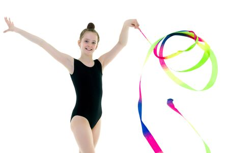 Girl gymnast performs exercises with tape. Stock Photo