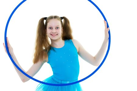 A girl gymnast performs an exercise with a hoop. 写真素材