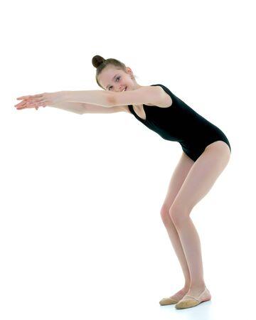 The gymnast prepares to perform the exercise. Banco de Imagens