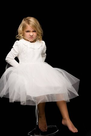 Portrait of a cute little girl on a black background