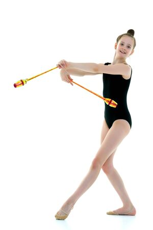 A girl gymnast performs exercises with a mace. 写真素材