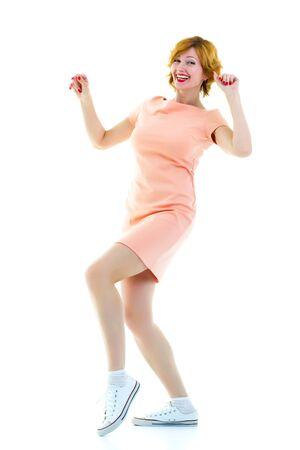Beautiful young woman dancing isolated in studio - series o