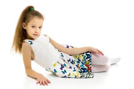Little girl ballerina in the image posing on the floor. Reklamní fotografie