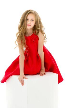 Portrait of Beautiful Preteen Girl in Red Dress Posing in Studio