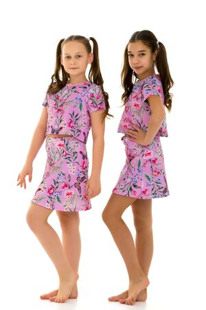 Two cute little girls in full growth Imagens