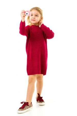 Lovely Blonde Little Girl Making Selfie with Toy Camera